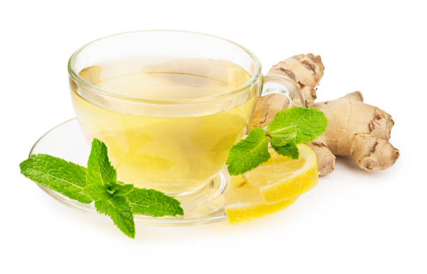 Healthy herbal tea with mint, ginger and lemon in a glass cup isolated on white