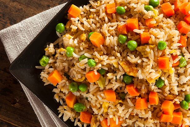 Healthy Homemade Fried Rice Healthy Homemade Fried Rice with Carrots and Peas fried rice stock pictures, royalty-free photos & images