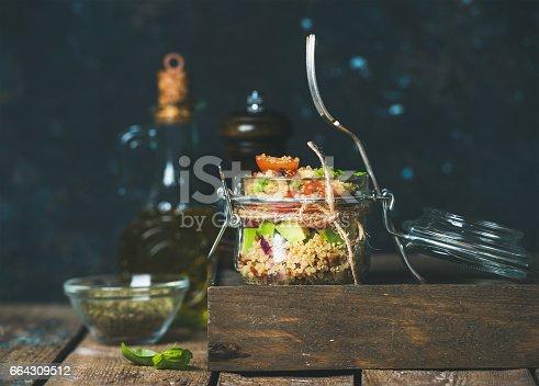 istock Healthy homemade jar quinoa salad with sun-dried tomatoes, avocado, basil 664309512