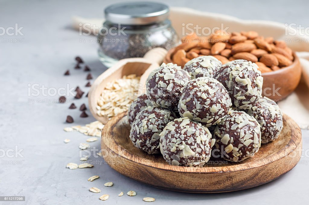 Healthy homemade paleo chocolate energy balls, horizontal, copy space stock photo