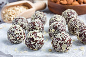 Healthy homemade paleo chocolate energy balls on parchment, horizontal