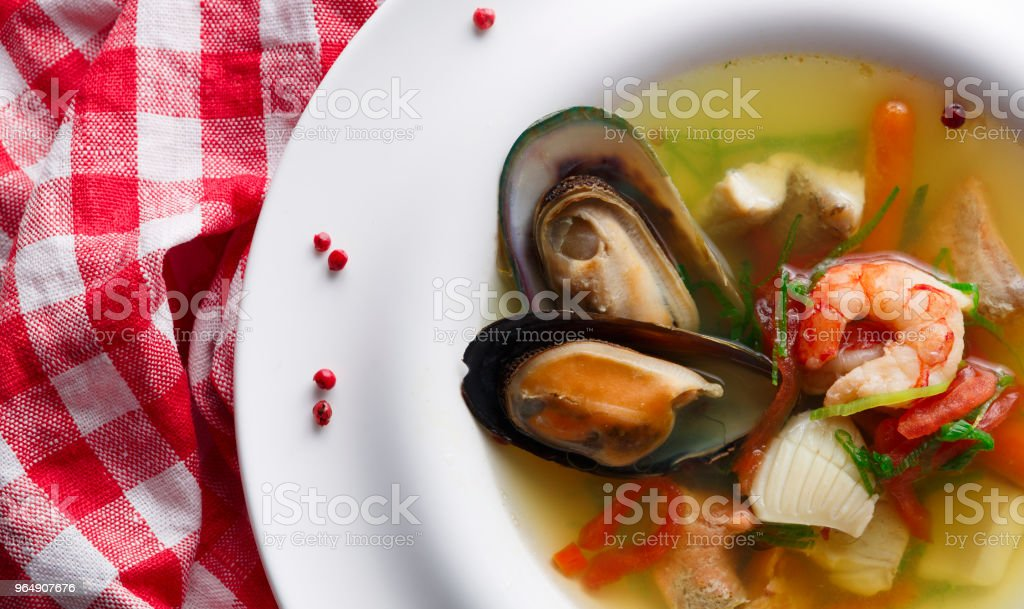 Healthy homemade seafood soup of white fish, shrimps and mussels royalty-free stock photo