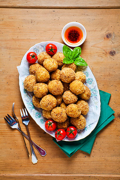 Healthy Italian Appetizer Tray with Risotto balls Arancini , Gre stock photo