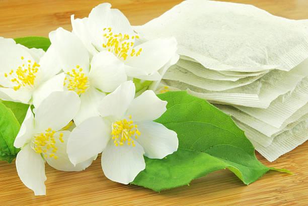 healthy jasmine teabags stock photo