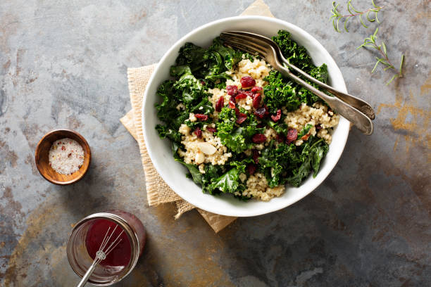 healthy kale and quinoa salad - quinoa stock photos and pictures