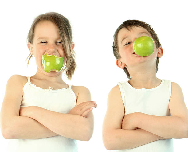 Healthy kids eating apples, White Background stock photo