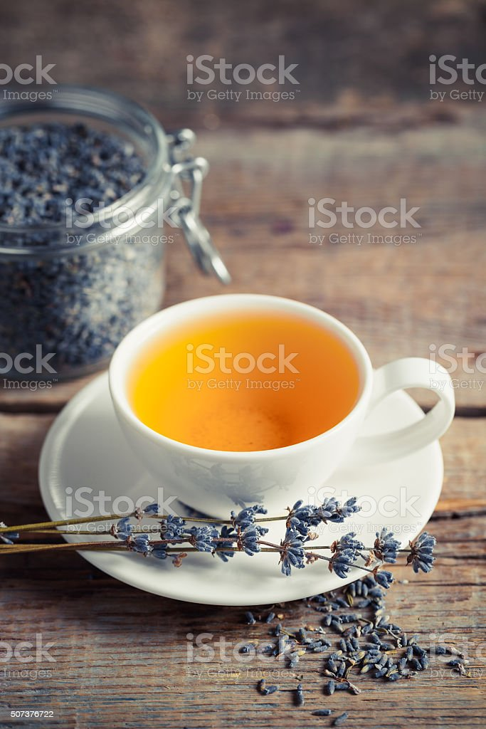 Healthy lavender herbal tea and dry lavender in jar. stock photo