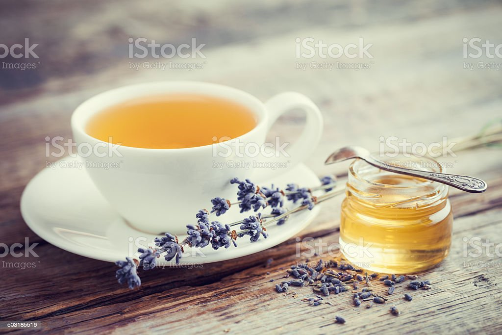 Healthy lavender tea cup, jar of honey and lavender flowers. stock photo