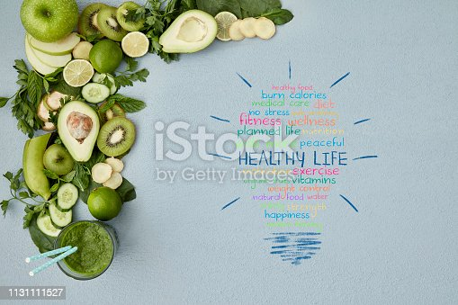 istock Healthy life words on table with smoothie and vegetable 1131111527