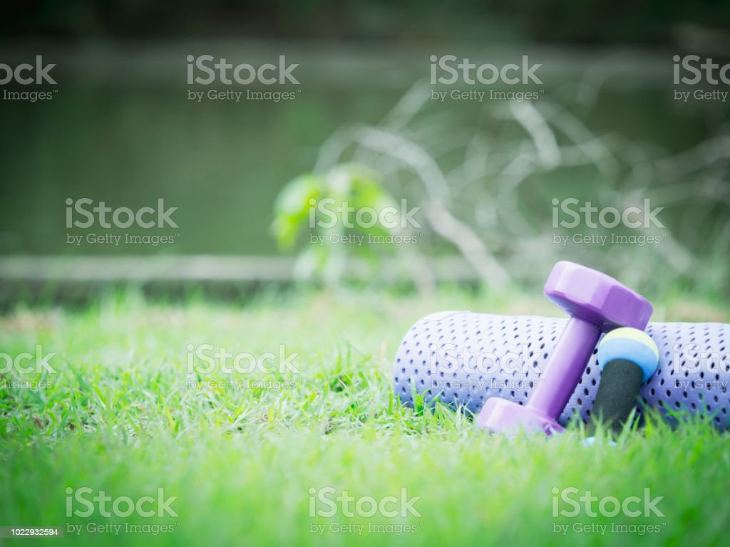 healthy lifestyle and outdoor concept from close up exercise object...