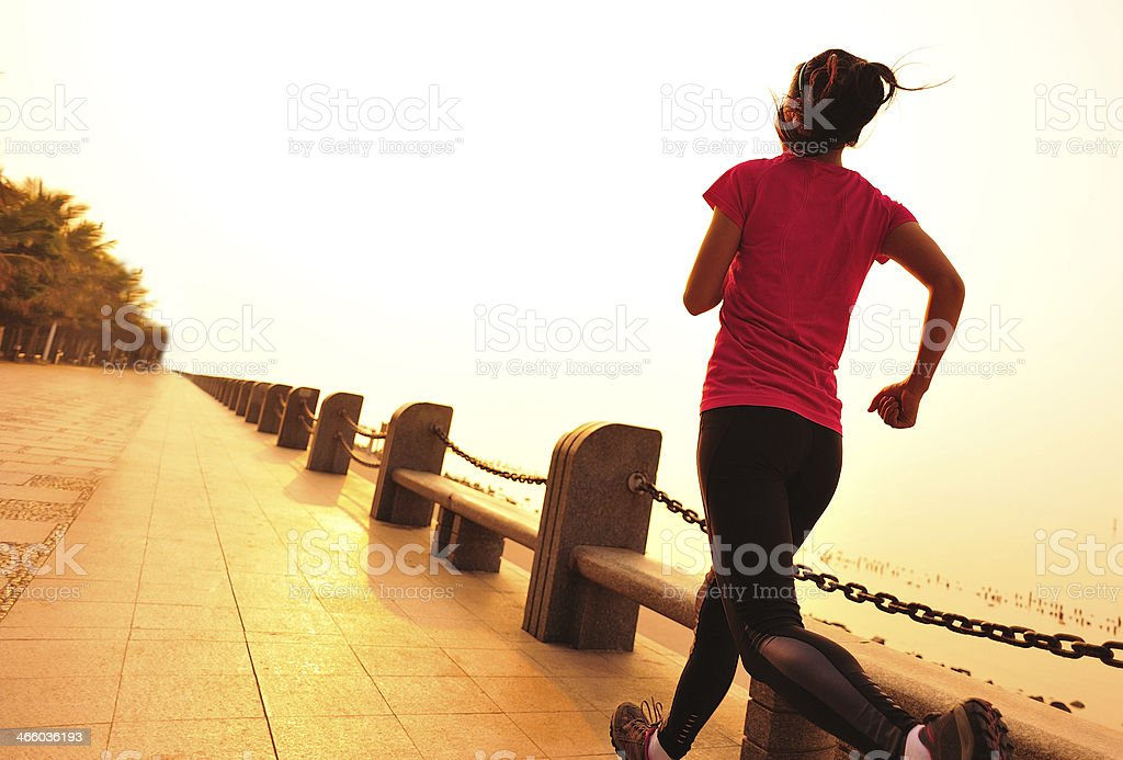 healthy lifestyle asian woman running at seaside royalty-free stock photo