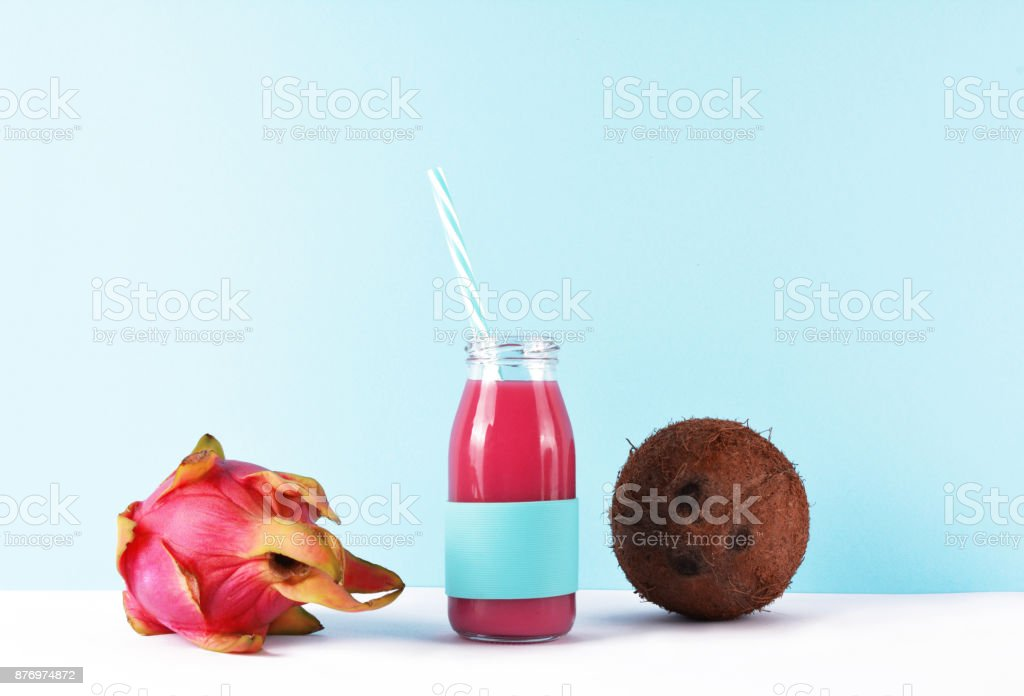 Healthy lifestyle concept: pink smoothie with tropical fruits on white table. stock photo