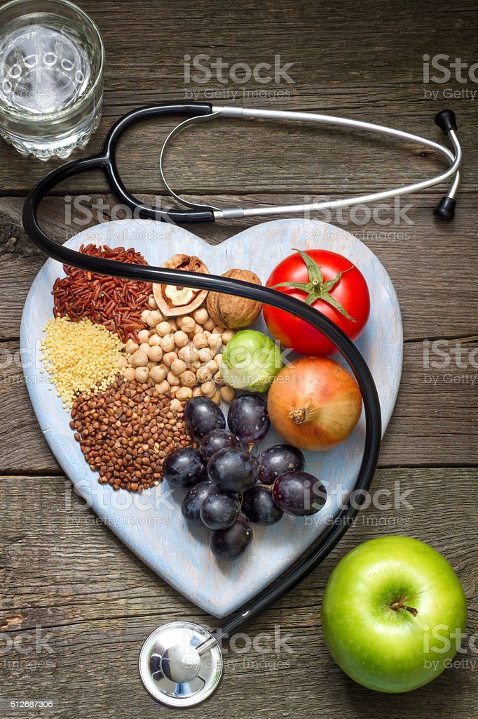 Healthy lifestyle concept with food on heart stock photo