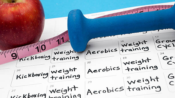healthy lifestyle: diet and exercise - calendar workout bildbanksfoton och bilder
