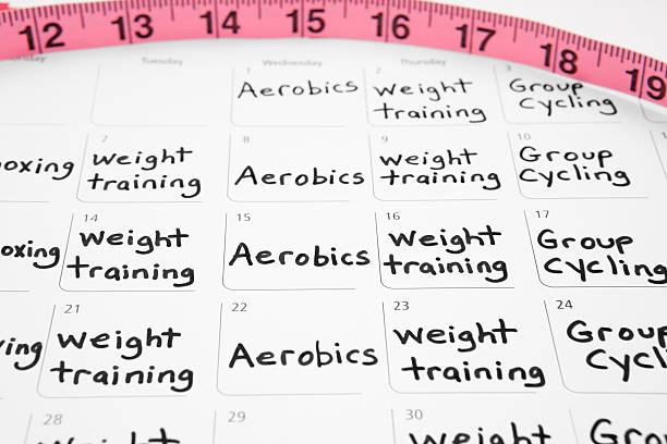 healthy lifestyle: exercise schedule on calendar - calendar workout bildbanksfoton och bilder