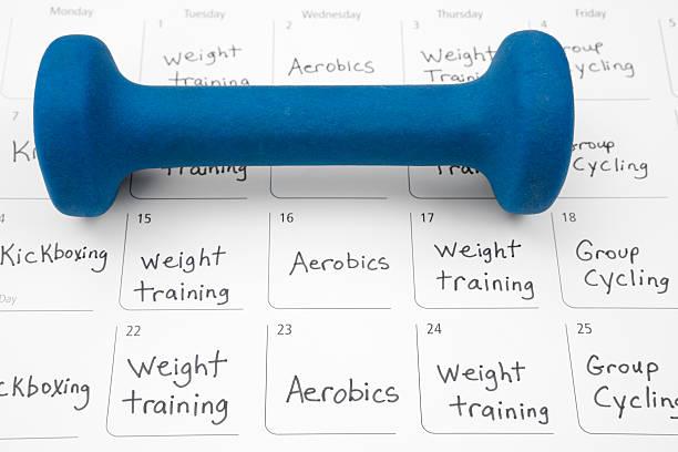 healthy lifestyle: exercise schedule - calendar workout bildbanksfoton och bilder