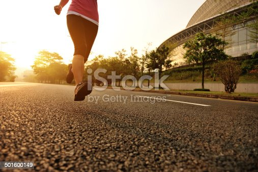istock healthy lifestyle fitness sports woman leg running on road 501600149