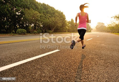 494003079 istock photo healthy lifestyle fitness sports woman  running at driveway 485493797