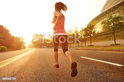 istock healthy lifestyle fitness sports woman  running at driveway 486068759