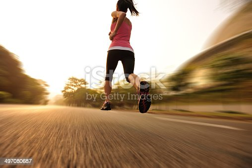 494003079 istock photo healthy lifestyle fitness sports woman  running at driveway 497080687