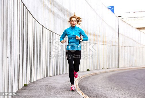 476391546 istock photo Healthy lifestyle fitness sports woman running in the city 472646578