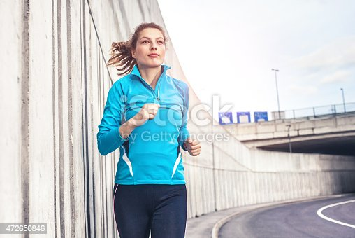 476391546 istock photo Healthy lifestyle fitness sports woman running in the city 472650846
