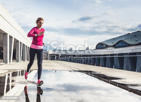 476391546 istock photo Healthy lifestyle fitness sports woman running in the city 474265962