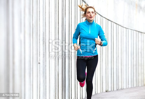 476391546 istock photo Healthy lifestyle fitness sports woman running in the city 475429396
