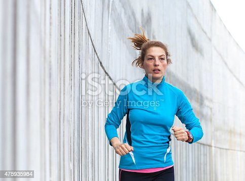 476391546 istock photo Healthy lifestyle fitness sports woman running in the city 475935984