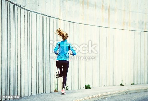 476391546 istock photo Healthy lifestyle fitness sports woman running in the city 502399326