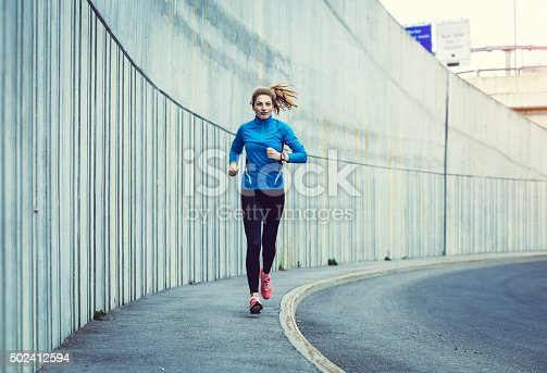 476391546istockphoto Healthy lifestyle fitness sports woman running in the city 502412594