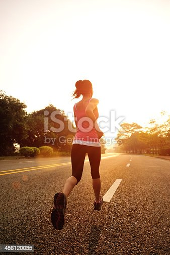 494003079 istock photo healthy lifestyle fitness sports woman  running on road. 486120035