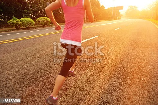 494003079 istock photo healthy lifestyle fitness sports woman  running  on road 486132599