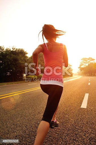 istock healthy lifestyle fitness sports woman  running on road 486355503