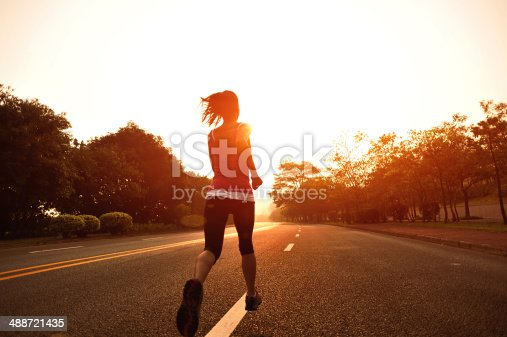 494003079 istock photo healthy lifestyle fitness sports woman running on road 488721435