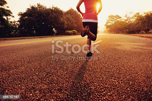 494003079 istock photo healthy lifestyle fitness sports woman running on road 488757167