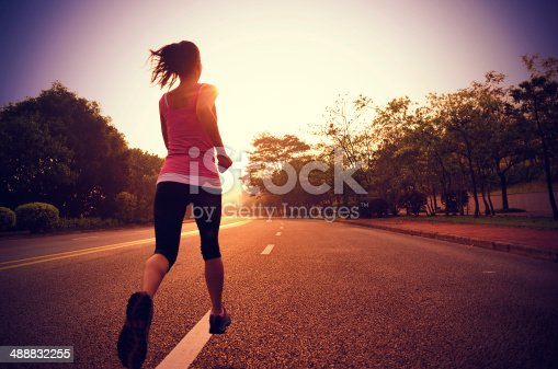 494003079 istock photo healthy lifestyle fitness sports woman running on road 488832255