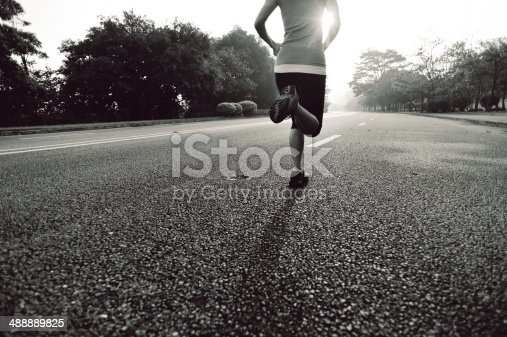istock healthy lifestyle fitness sports woman running on road 488889825