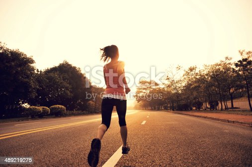 istock healthy lifestyle fitness sports woman running on road 489219275