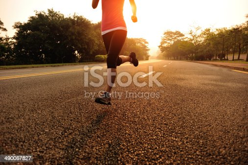 476391546istockphoto healthy lifestyle fitness sports woman running on road 490067827