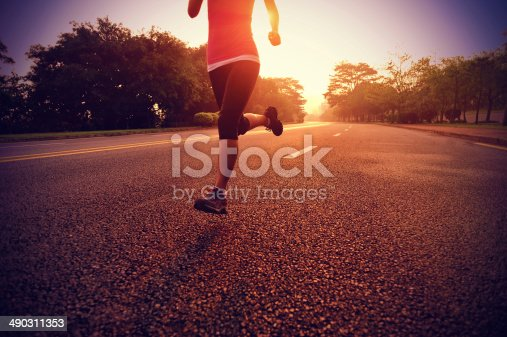 istock healthy lifestyle fitness sports woman running on road 490311353
