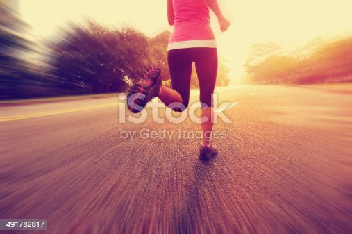 502412594 istock photo healthy lifestyle fitness sports woman running on road 491782817