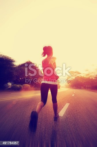 istock healthy lifestyle fitness sports woman running on road 491784057