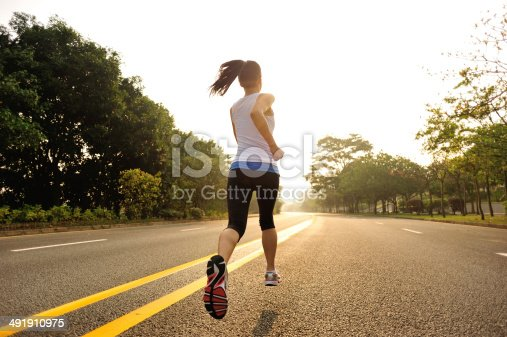 istock healthy lifestyle fitness sports woman  running on road 491910975