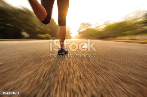 istock healthy lifestyle fitness sports woman running on road 494003079