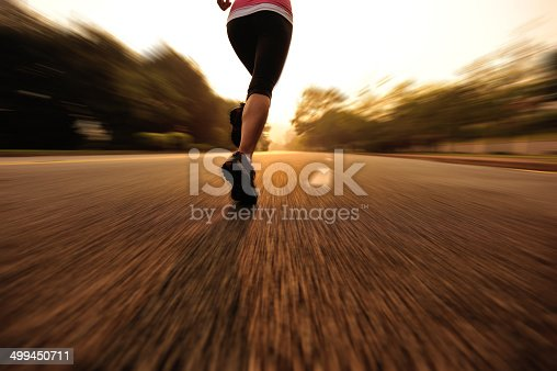 494003079 istock photo healthy lifestyle fitness sports woman running on road 499450711