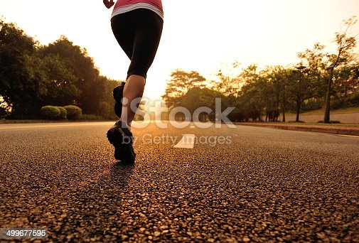494003079 istock photo healthy lifestyle fitness sports woman running on road 499677595