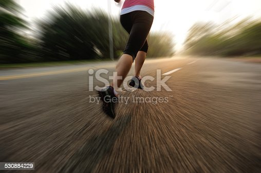 494003079 istock photo healthy lifestyle fitness sports woman running on road 530884229