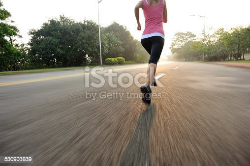 494003079 istock photo healthy lifestyle fitness sports woman running on road 530903639