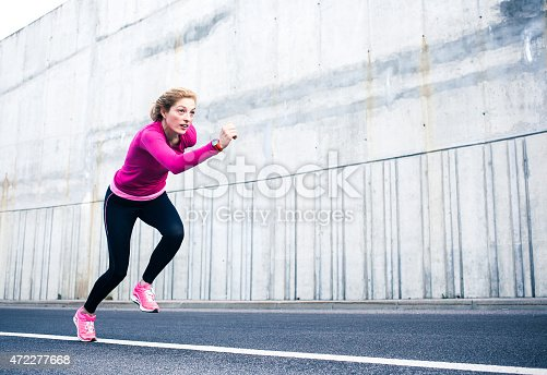 istock Healthy lifestyle fitness sports woman running 472277668